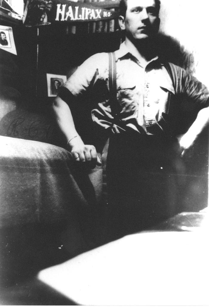 Russill in radio cabin, ca. 1944. Item number: HCSR-40-05.