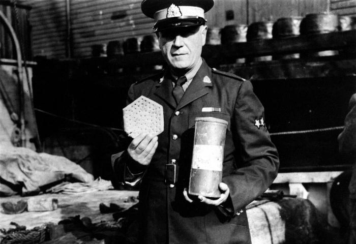 Henry Larsen holding hardtack & oxtail soup, 1944. Item number: HCSR-40-09.