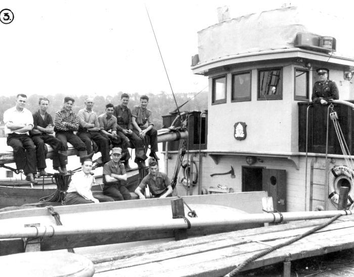 Crew on boom, ca. 1944. Item number: HCSR-40-22.