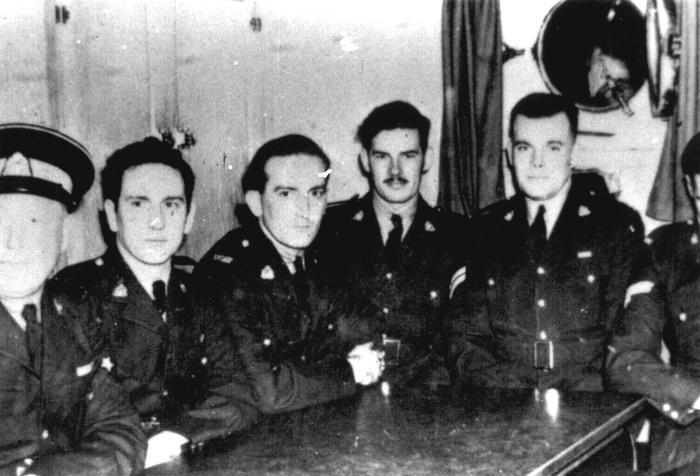 Men in uniform at mess table, 1944. Item number: HCSR-40-42.