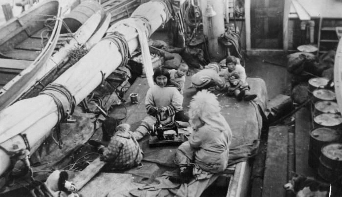 Panipakuttuk family on cargo hatch, 1944. Item number: HISG-40-01.