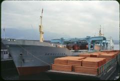 Port bow, at dock, loaded with lumber