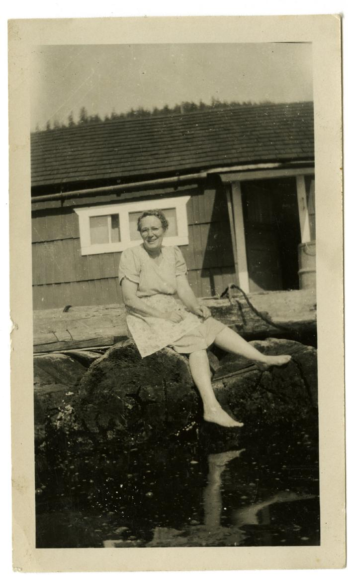 Florence Benson in front of their float house (VMM71.34)