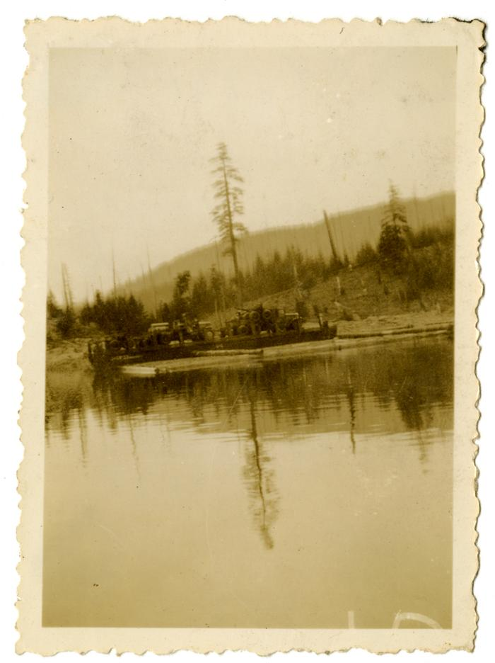Clay Anderson's logging trucks on a barge, Granite Bay (VMM71.56)
